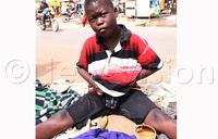 Helpless street kid passes stool through stomach