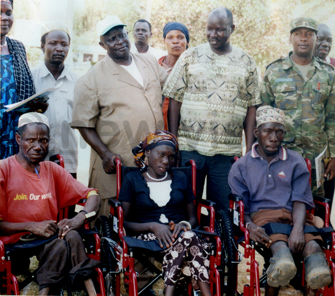 biriga with beneficiaries of wheel chairs in rua donated by the otary lub of engo