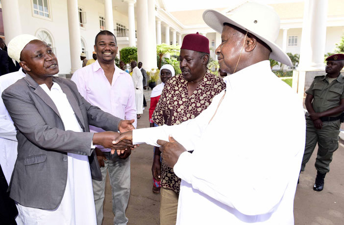 resident oweri useveni greets hmed aregga usaazi while alim huru and oses igongo look on