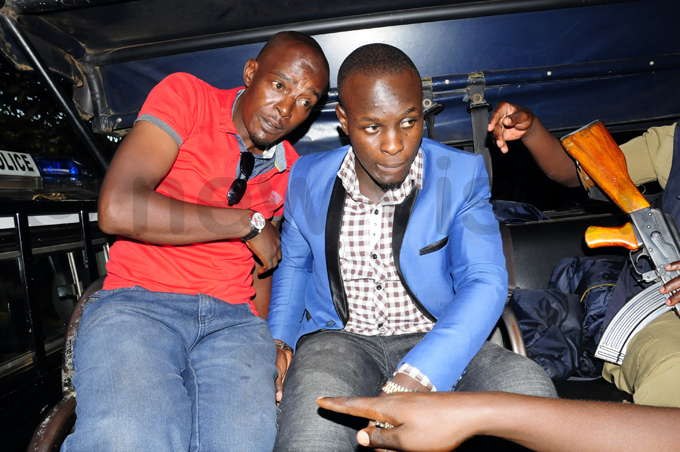 wo men believed to be abafunzakis accomplices aboard a olice truck after they were arrested at erena otel hoto by ddie sejjoba