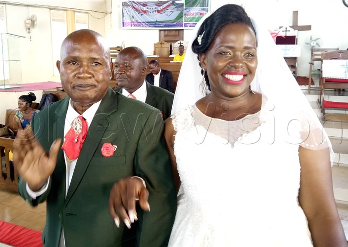 ane and ames arry wesigwa during their wedding day at hrists athedral ugembe in inja district