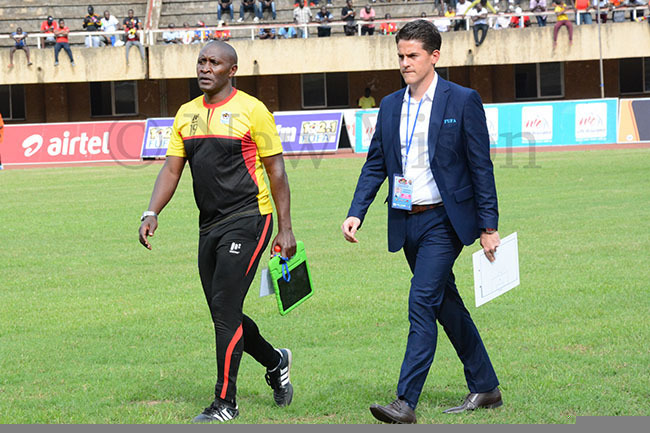 ranes oach ohnny cinstry walks to the pitch with one his assistants ivingstone babazi