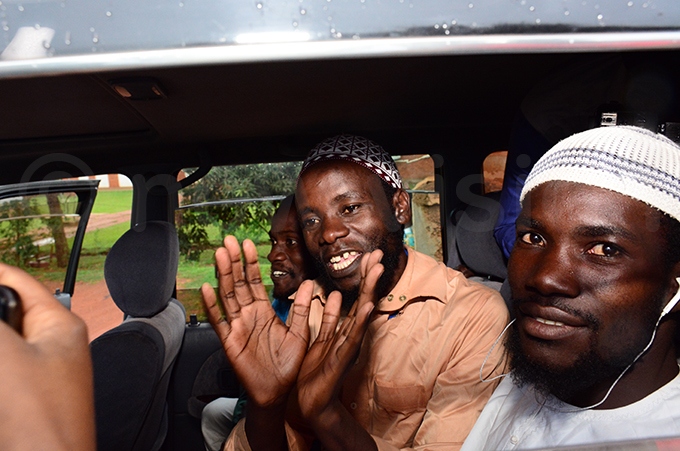 asujja and alyejusa being driven away after court dismissed the case hoto by imothy urungi