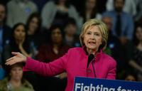 Clinton slams unrealistic Sanders 'promises' in debate
