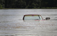 In pictures: 40,000 homes flooded in Louisiana