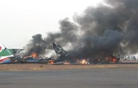 Military planes collide at airport, 8 injured