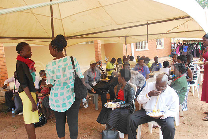 ealth workers take a break after handling patients at ira hospital