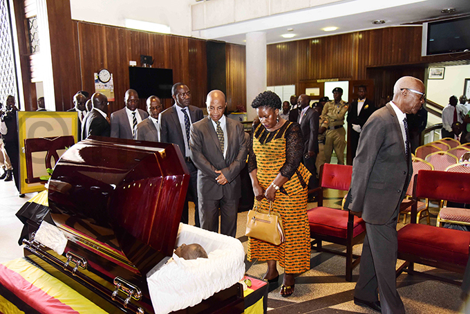 s pay their last respects to eter yombi at arliament hoto by ennedy ryema