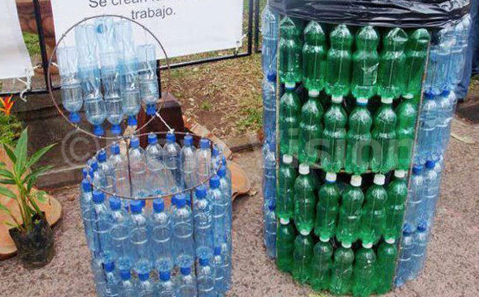nstead of littering one can recycle plastics ere is a dustbin made out of plastic bottles ile hoto