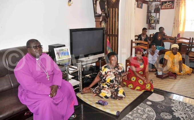 ishop ackson atovu joined other mourners at igongos home on ednesday hoto by enry subuga