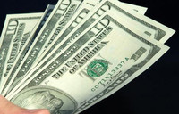 Dollar holds euro gains but dips against emerging units