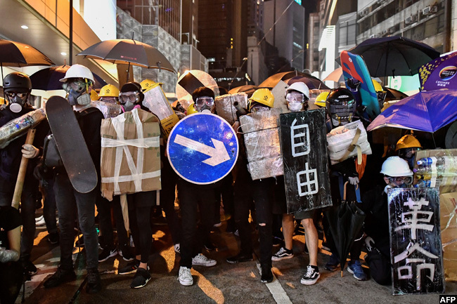 n uly these protesters stood together with makeshift shields including a road sign and skateboard during clashes with police in ong ong