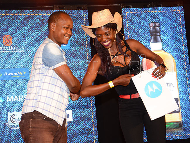 artha abirye was a double winner on the night taking the longest and nearest to the pin prizes atrick afeero offers a rare handshake due to the oronavirus