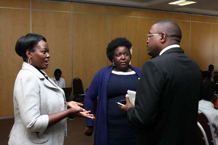 unice usiime the executive director at kina ama a frika chats with some of the panellist