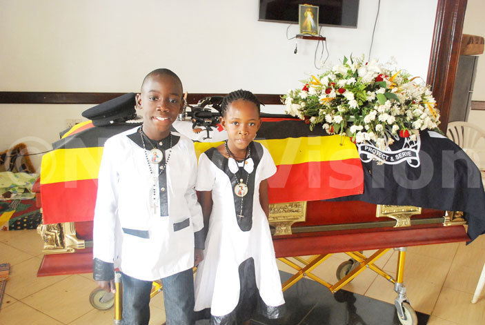 ictor aweesi and leopatra aweesi against their late fathers casket