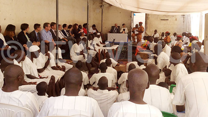 vhe fficer in harge of uzira pper rison elestine umwesigye addresses death row inmates as tephanie ivoal the rench ambassador and  head of delegation tilio acifici and look on