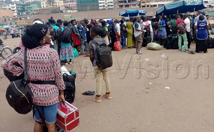 assengers to the astern region lining up to book tickets at amayiba bus terminal hoto amuel alagadde