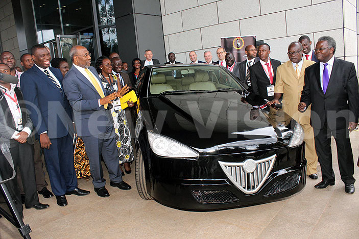 r uhakana ugunda government officials and iira otors orporation  founders standing next to the iira  edan car at the launch of the iira otors usiness ase rogram late last year credit ony ujuta