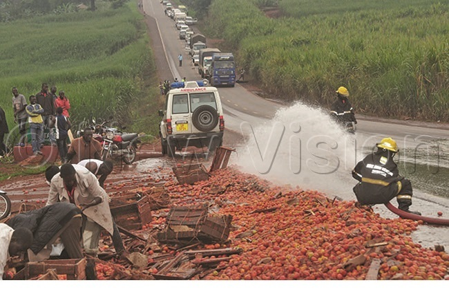 he ire rigade crew washing away tomatoes that had spilled on the highway during an accident in abira orest