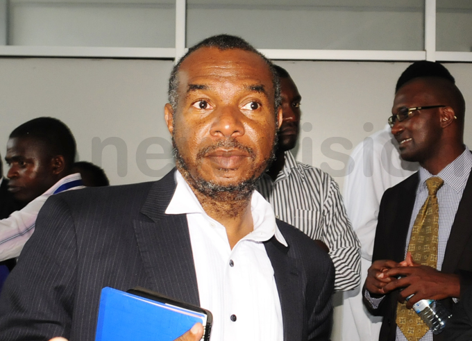 uhammed babazi one of the petitioners lawyers cuts a forlorn figure after the ruling was delivered hoto by ddie sejjoba
