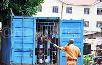 Inmates locked up in a container