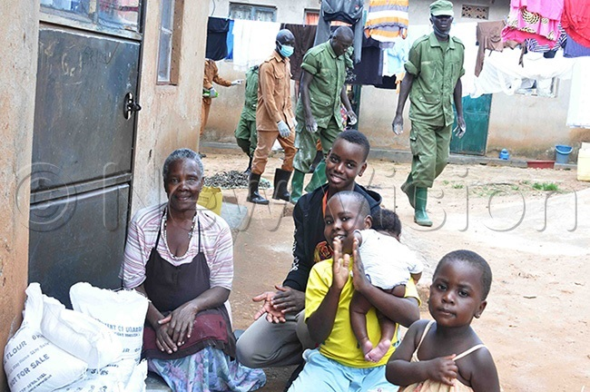 hildren and their father excited after receiving food relief