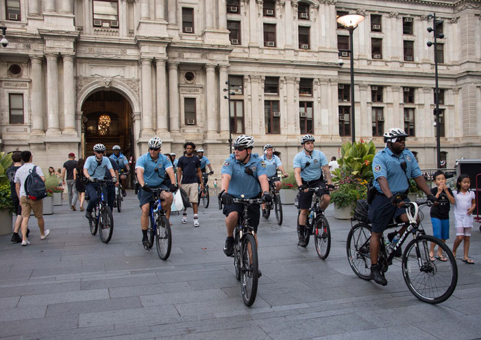 olice patrol on bicycles in front of ity all in hiladelphia