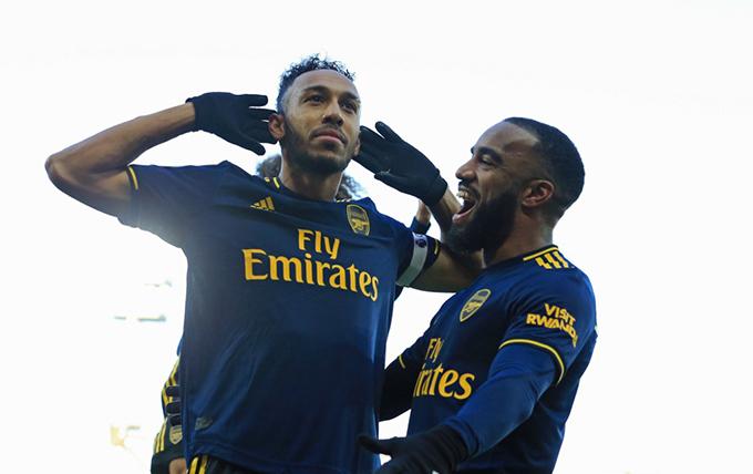 rsenals ierremerick ubameyang celebrates with lexandre acazette after scoring their first goal from the penalty spot  hoto
