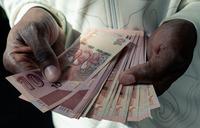 Zimbabwe suspends mobile banking, stock exchange trade