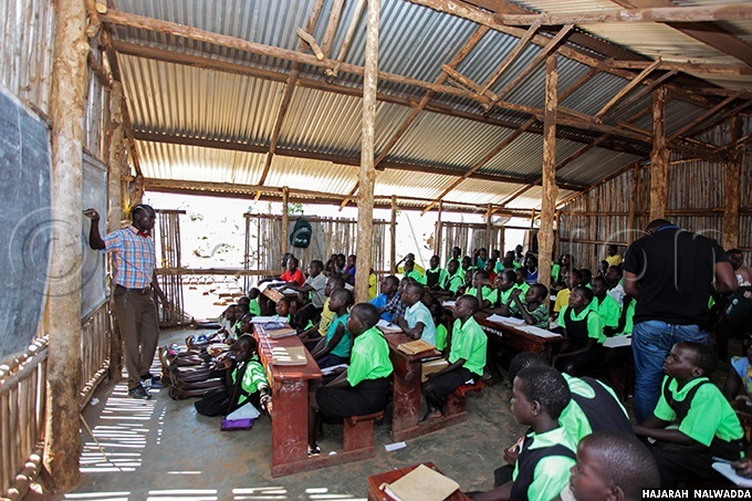 teacher teaching pupils of orld iew rimary chool and  at alabek refugee settlement alabek gili ub ounty amwo district orthern ganda hoto by ajarah alwadda