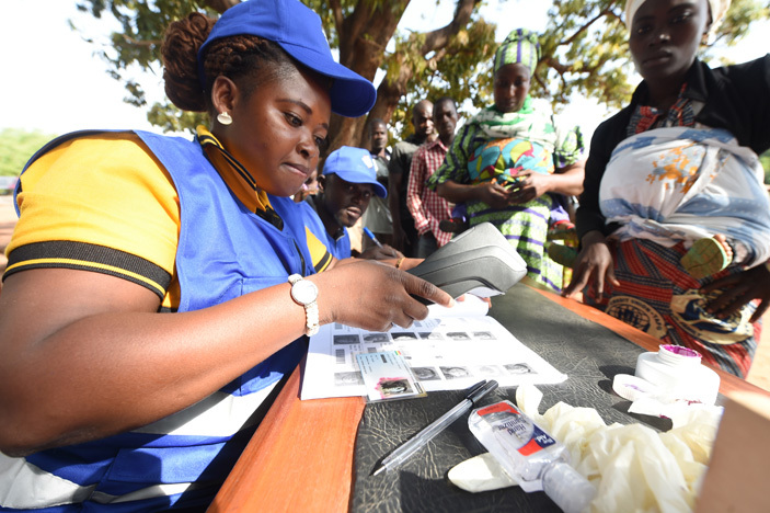 n electoral official uses a biometric machine to validate voters card at a polling booth in the ole district northern region on ecember 7 2016