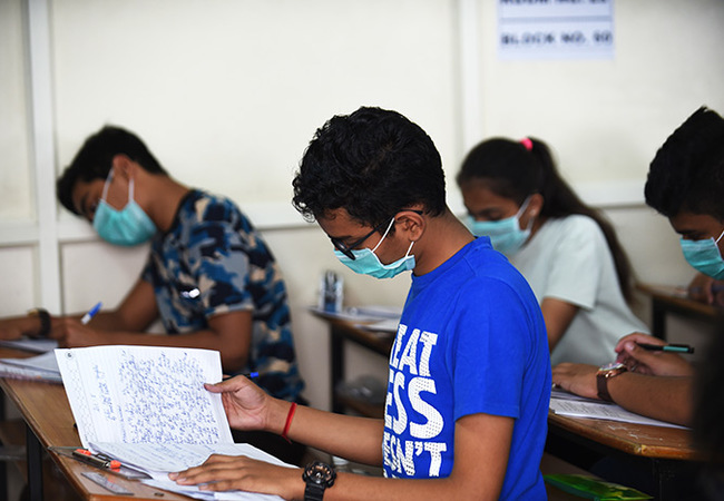 tudents sit for the ujarat oard th examination as they wear facemasks provided by the school management at adhana inay andir chool following the 19 coronavirus outbreak in hmedabad on arch 5 2020 hoto by