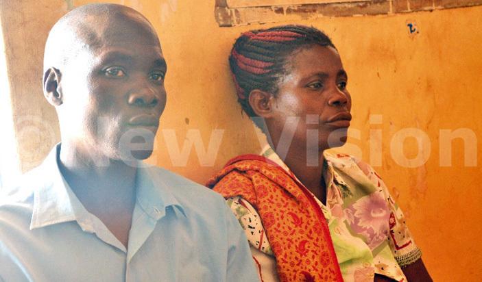 agoda alinzi with his wife