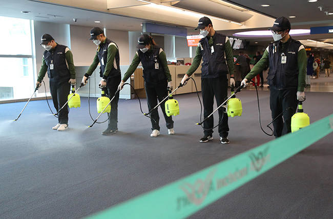 orkers from a cleaning service spray disinfectant at the customs immigration and quarantine  area at ncheon international airport west of eoul on anuary 21 2020  outh orea on anuary 20 confirmed its first case of the like virus that is spreading in hina as concerns mount about a wider outbreak hoto by        outh orea