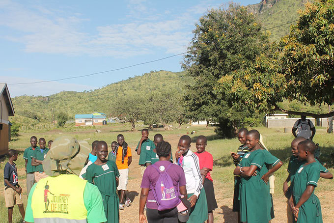upils of apuat rimary chool welcome the alkers to riiri sub county head quarters