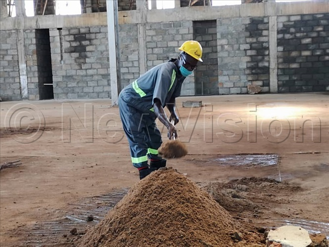 A worker wearing his mask on duty