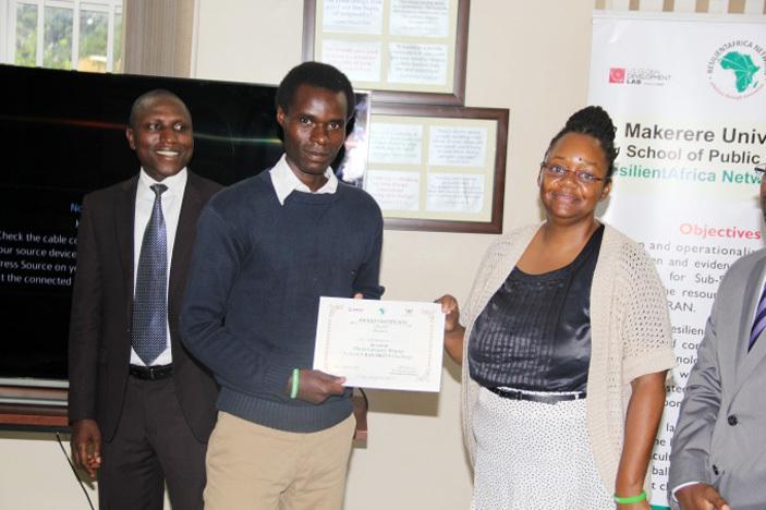 verall photo category winner ob yabarema receiving a certificate