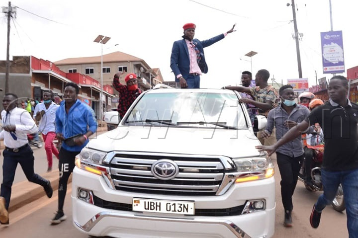 Artiste Joseph Mayanja alias Jose Chameleon waving at crowds (Photos by Patrick Kibirango)