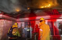 California on high alert as fires destroy dozens of homes
